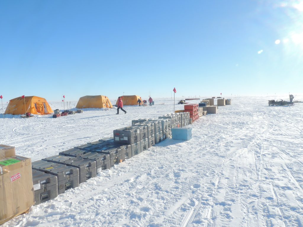 Camp site with seismic equipment in front