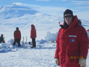 At snow camp. Ralph Stephen from Woods Hole Oceanographic Institution (one of our team) with Mt. Erebus in the background. Mt. Erebus is an active volcano, and you can see a plume of water vapor/gasses coming out of the top.