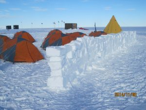 The wall is intended to shield our tents from strong winds, which are common.