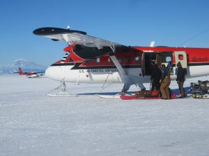 Loading our gear and the seismic station onto the Twin Otter at Willy Field, with Mt. Erebus in the background.