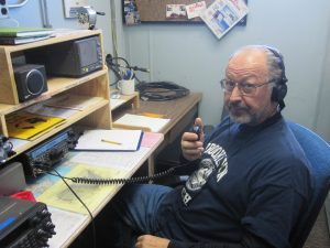 Ron Flick with his thumb on the pulse of McMurdo, talking to the world.